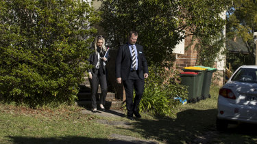 Detectives leave the house where Jack and Jennifer Edwards were murdered by their father, John Edwards, in 2018.