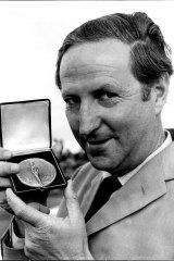 William McBride pictured at Sydney Airport holding the medal presented by the Institute De La Vie in Paris.