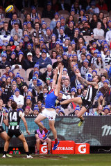 Jeremy Howe with the mark (that wasn't) over Tom McDonald during the Queen's Birthday clash at the MCG.