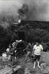 """Volunteers man garden houses as the fire approaches the Kamerigal Restaurant, Morgan Road, Belrose."" December 17, 1979."