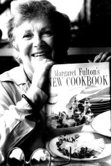 Fulton with one of her 20 cookbooks.