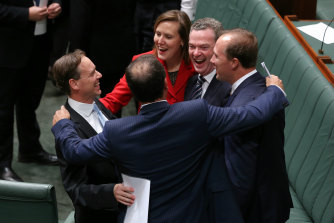"As the former environment minister celebrating the lower house's 2014 repeal of Labor's ""carbon tax""."