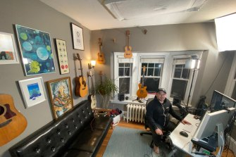 Podcaster and songwriter Jonathan Mann of 'Song a Day' in his home studio.
