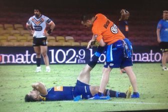 Play is stopped while Gold Coast centre Young Tonumaipea receives urgent treatment for cramp.