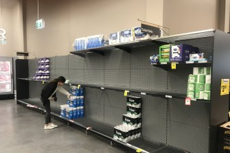 Almost empty shelves in a supermarket in Sydney.