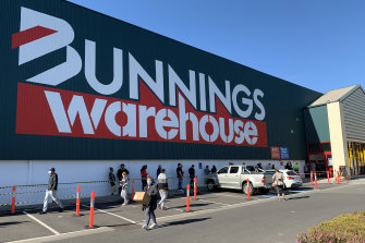 A long queue forms outside Bunnings, Northlandon Sunday as Melburnians face tougher stage four lockdown restrictions within days.