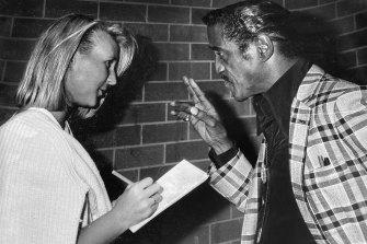 Sammy Davis Jr delivering some sage advice to a 19-year-old Kate Halfpenny.