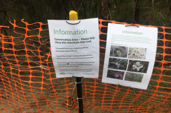 Temporary signs and fencing at Studley Park to protect a conservation area of wildflowers.