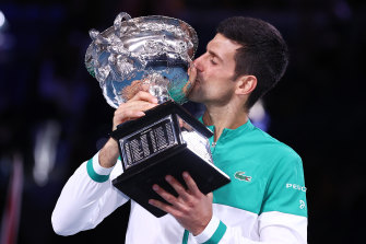 Novak Djokovic savours the moment with the trophy.
