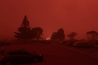 The scene during the height of the bushfires last January at Malua Beach, near NSW Transport Minister Andrew Constance's residence. Mr Constance returned home in time to put out a fire that had begun on his verandah.