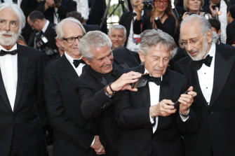 Previous former Palme d'or winners from left, Michael Haneke, Ken Loach, Claude Lelouch, Roman Polanski and Jerry Schatzberg at the 70th Anniversary of the film festival, Cannes, southern France in 2017.