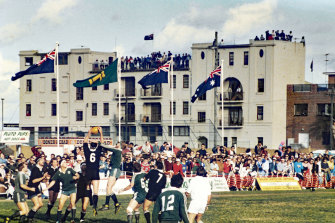 Residents fill nearby rooftops when the All Blacks played at Coogee Oval in 1988.