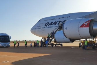 Australians arrive at RAAF Base Learmonth in WA on a Qantas flight from China on February 4 last year.