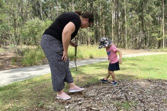 Looking for clues: Mum Katrina Hohn and daughter Ellie look for seed pods at Karawatha Forest Discovery Centre.
