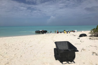 The crew unloads gear onto the beach as they arrive on Kure Atoll.