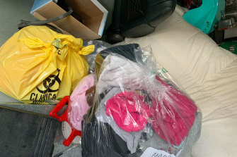 """Some of the bags of belongings sent to Maureen O'Brien's family, along with a bag marked """"clinical waste""""."""