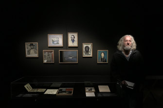 Artist Hadyn Wilson at the exhibitionFake Truths: An Historical Novel at the State Library of NSW.