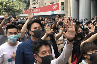 Protesters march outside the HSBC building in Hong Kong on Friday.