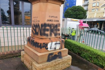 Images of the defaced Captain Cook statue on Belmore Road, Randwick. It has since been cleaned by council rangers.