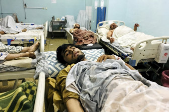 Wounded Afghans lie in hospital after the deadly explosions outside the airport in Kabul.