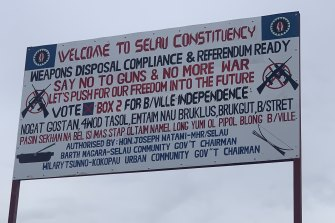 A sign advertising a weapons surrender process and urging an independence vote on Bougainville.