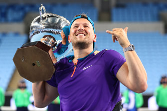 Dylan Alcott celebrates after winning his seventh consecutive Australian Open title early on Thursday morning.