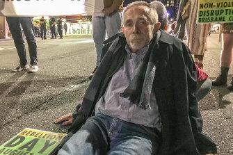 Brisbane man Frank Moeller glued himself to Grey Street, South Brisbane.