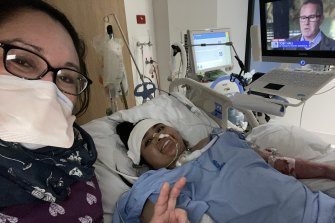 Saela in hospital with her mother, Michelle, as she recovers from COVID-19.