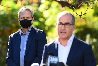 Victoria's Chief Health Officer Professor Brett Sutton looks on as acting Premier James Merlino speaks to the media on Monday.
