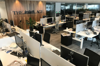 The Age's newsroom was empty on Thursday as journalists, editors and production staff worked from home.
