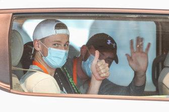 Australian tennis player Blake Mott in a players transport van from the Grand Hyatt to practise for the Australian Open.