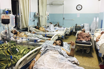 Wounded Afghans from the attacks outside the airport in Kabul.