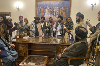 Taliban fighters take control of Afghan presidential palace in Kabul, Afghanistan on August 15.