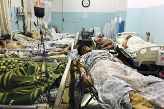 Afghans who were injured in the explosions outside the Kabul airport lie in hospital.