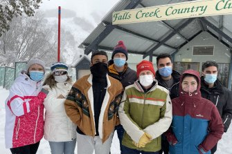 George Kyriazis, 27 (third from right) arrived at Falls Creek with a group of friends on Thursday morning, only to learn they were about to be in lockdown.
