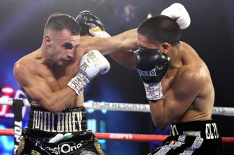Andrew Moloney and Joshua Franco exchange punches during their controversial fight for the WBA super flyweight title on November 14.