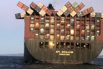 Containers cling precariously to  APL England after other cargo fell overboard in May.