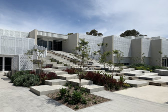 The unusual form reaches out to a northern courtyard that links to an existing school building.