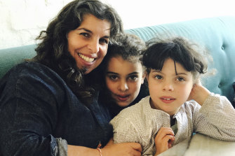 Nicole Azzopardi with her daughters, aged eight and nine.