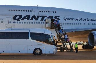 Australians arrive at RAAF Base Learmonth in WA on a Qantas flight from China on February 4.