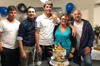Christopher Cassaniti (centre) celebrating his 18th birthday with his family.