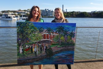 Artist Donna Gibb (left) with Cressida Ward holding her wedding painting.