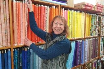 Joy Bolte checks her fabric supplies