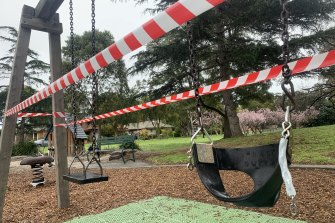 Tape blocks off access to swings at Basterfield Park in Hampton Easton Tuesday, as stricter COVID-19 restrictions came into effect in Melbourne.