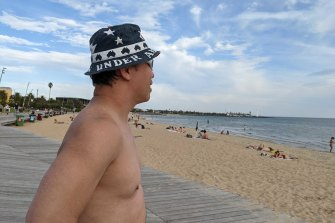 Paul Nguyen had his last ocean swim before the weekend's wintry blast forces his to pack away his flippers.