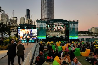 Crowds at South Bank, Brisbane, gather to hear the IOC's decision.