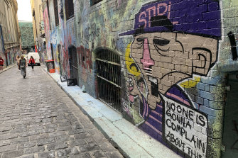 """Adding to the debate: New graffiti art on Hosier Lane after the """"paint-bombing""""."""