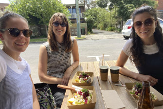 Kate Prowse (right) catches up over lunch with colleagues Sarah Shaw (left) and Chloe Herbert.