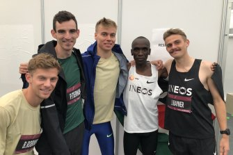 Brett Robinson, Pat Tiernan, Stewart McSweyn, Eliud Kipchoge and Jack Rayner celebrate after the race.