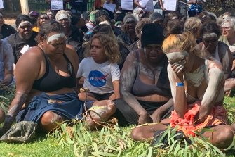 Local members of the community mourn the death of Warlpiri man Kumanjayi Walker in Alice Springs on Thursday.